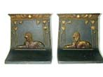 click to view detailed description of A Pair of Bradley & Hubbard Sphinx Bookends circa 1922.