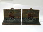 click to view detailed description of A Pair of BRADLEY & HUBBARD Hand Painted Ship Bookends With Original Paper Labels circa 1910