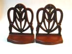click to view detailed description of A Pair of Antique Bookends by BRADLEY & HUBBARD Depicting a