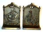 click to view detailed description of A Fine and Rare Pair of Antique Bookends by BRADLEY & HUBBARD Depicting