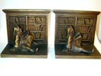 click to view detailed description of A Pair of BRADLEY & HUBBARD Antique Bookends Featuring a GNOME in a Library circa 1924