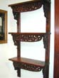 click to view detailed description of A Civil War Era Carved Walnut Three-Tiered Shelf circa 1860-1870