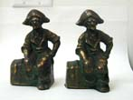 click to view detailed description of A Pair of Pirate Sitting on a Treasure Chest Antique Bookends circa 1890