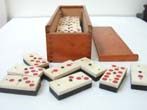 click to view detailed description of An Unusual Cased Set of 24 Bone and Ebony Dominoes with Red Dots circa 1890