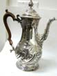 click to view detailed description of A Magnifiscent George II Sterling Silver Coffee Pot by Benjamin Godfrey, London 1759