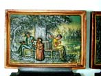 click to view detailed description of A Charming pair of Bradley & Hubbard Antique Bookends Depicting a Family Sitting Under a Tree