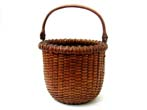 click to view detailed description of A Fine Small Nantucket Basket circa 1880
