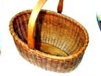 click to view detailed description of A Rare Oval Nantucket Basket by Ferdinand Sylvaro circa 1910.
