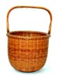 click to view detailed description of An Outstanding Nantucket Basket Made by M.W. Sandsbury in 1953