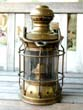 click to view detailed description of A late 19th Century American Ships Lamp with Mounting Bracket circa 1890
