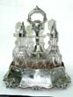 click to view detailed description of An Attractive English Engraved Silver 7 Bottle Cruet Set by George Angell, London, 1855