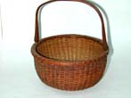 click to view detailed description of A Late 19th century swing handle Nantucket Basket