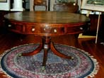 click to view detailed description of A Fine Leather Topped English Regency Period Revolving Library drum Table circa 1815