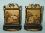 click to view detailed description of A good pair of Antique Bookends by Bradley& Hubbard circa 1920 depicting a log cabin