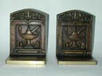 click to view detailed description of a Pair of Antique Bookends by Bradley & Hubbard depicting the symbols of Learning