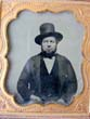 click to view detailed description of A mid 19th century Ambrotype of a bearded Man wearing a hat circa 1850-1870