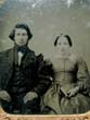 click to view detailed description of A Mid 19th century Ambrotype of a seated Lady and Gentleman