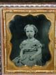 click to view detailed description of A Charming mid 19th century ambrotype of a pretty young girl
