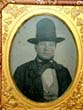 click to view detailed description of A Mid 19th century Ambrotype Image of a Man wearing a tall hat