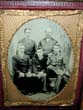 click to view detailed description of A late 19th century Ambrotype (?) Image of Three Young Men with Two Gentlemen